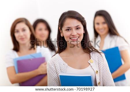 Group of female students holding notebooks - isolated - stock photo