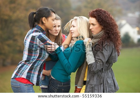 Group Of Female Teenagers Bullying Girl - stock photo