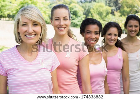 Group of female volunteers participating in breast cancer awareness - stock photo