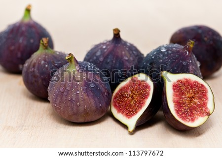 group of figs, covered with waterdrops - stock photo