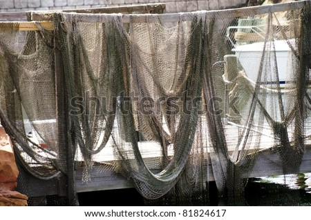 Group of Fishing Nets Hanging Out to Dry - stock photo