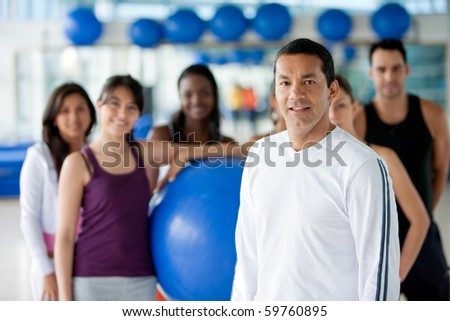 Group of fit people at the gym - stock photo