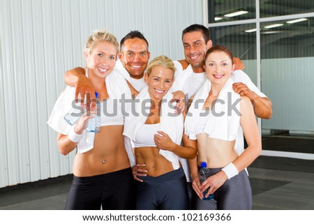 group of fitness people portrait in gym - stock photo