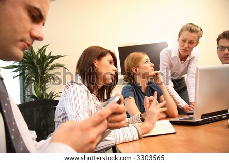 Group of five business people working together on project - three men and two women - stock photo