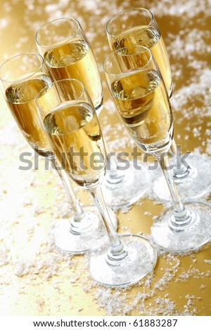 Group of five flutes of champagne on festive table - stock photo