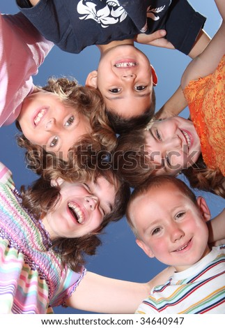 Group of Five Silly Friends Huddles and Laughing Outside - stock photo