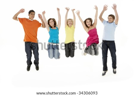 Group Of Five Young Children Jumping In Studio - stock photo