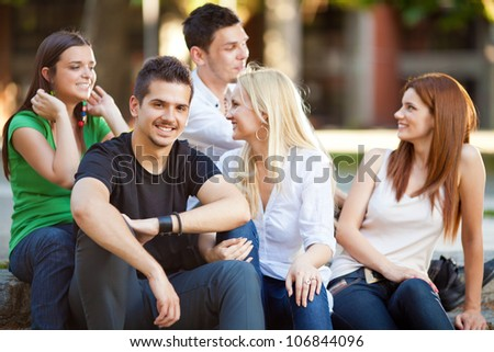 Group of five young student friends outdoors - stock photo