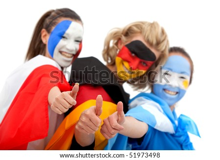 Group of football fans with their faces painted and their thumbs up - Isolated over white - stock photo