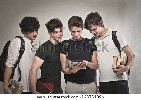 Group of four friends with a tablet - stock photo