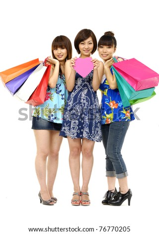 group of four happy young adult women out of shopping with colorful bags - stock photo