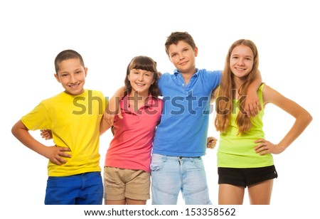 Group of four kids, boys and girls in colorful shirts hugging together