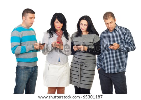 Group of four people in a row using their phones  to writing or reading SMS isolated on white background - stock photo