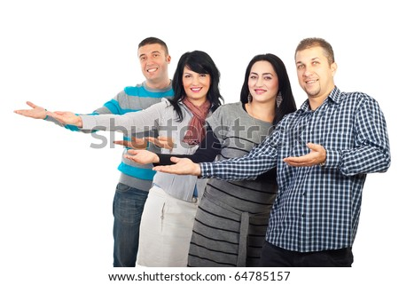 Group of four people making presentation or welcoming and all of them standing with palms open to copy space isolated on white background - stock photo