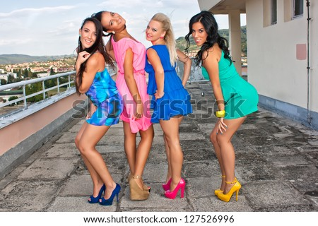 Group of four sexy young happy girls - stock photo
