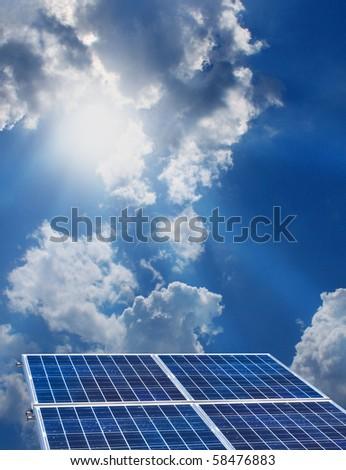 Group of four solar panels on sunny blue sky background - stock photo