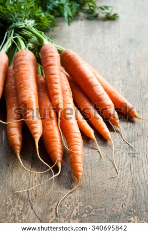 group of Fresh Carrots on wooden background  - stock photo