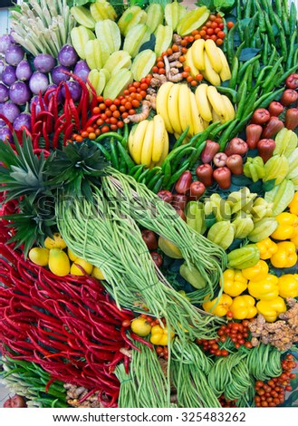Group of fresh fruit and colourful vegetable as background - stock photo