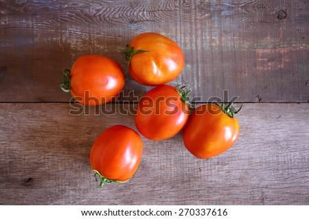 Group of Fresh Red Tomatoes on Wooden as Background, Shooting from Top view. - stock photo