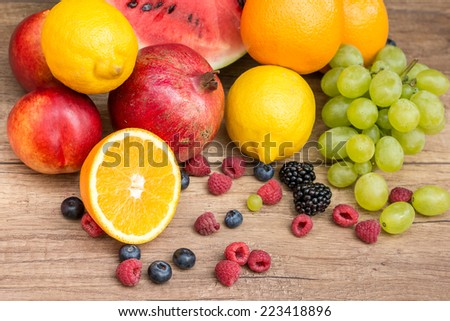 Group Of Fresh Summer Fruits On Wood Table - stock photo