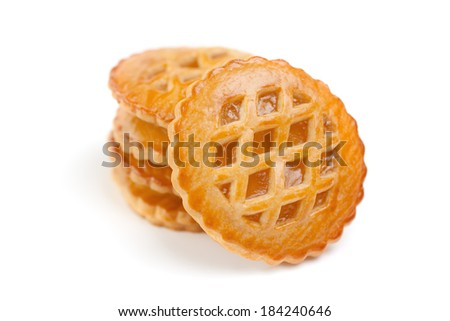 Group of freshly baked homemade small pies, isolated on white background