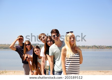 Group of friends at beach - stock photo