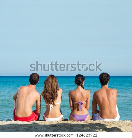 Group Of Friends At Beach Looking at The Horizon - stock photo