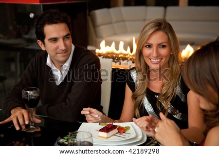 Group of friends at dinner in an elegant restaurant - stock photo