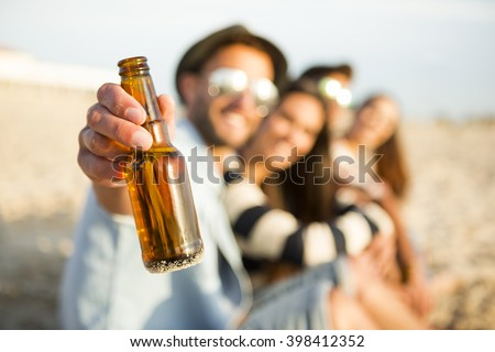 Group of friends at the beach having fun - stock photo