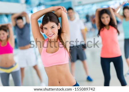 Group of friends at the gym stretching  - stock photo