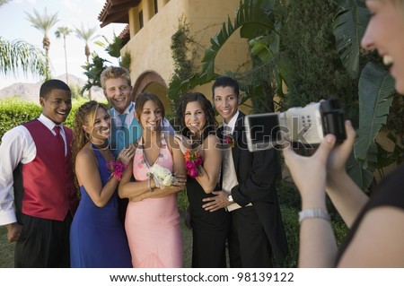 Group of Friends Being Videotaped at Prom - stock photo