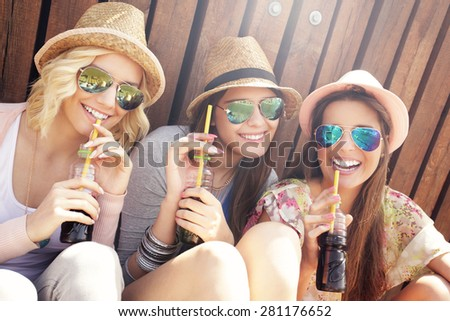 Group of friends drinking cocktails in the city - stock photo