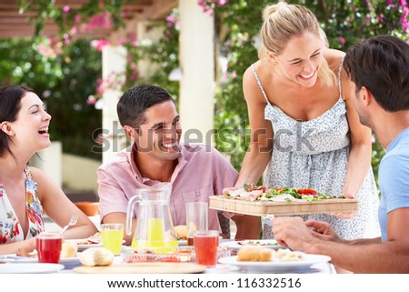 Group Of Friends Enjoying Meal outdoorss - stock photo