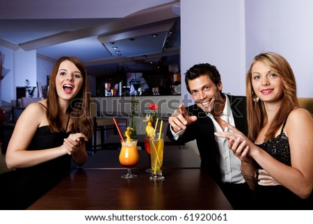 Group of friends enjoying show. Focus on women on the right - stock photo