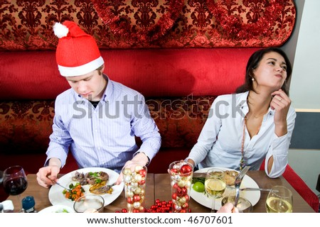 Group of friends enjoying their christmas dinner in a restaurant - stock photo