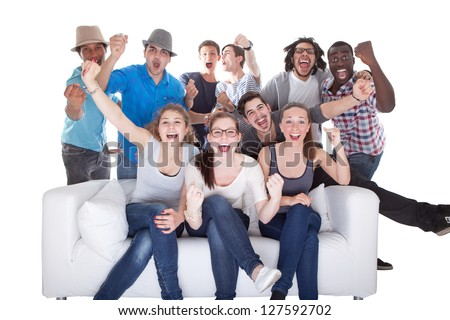Group Of Friends Enjoying Watching Television On White Background - stock photo