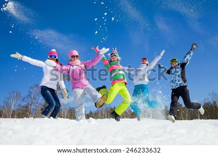 group of friends have a good time in winter resort - stock photo
