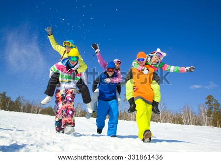 group of friends have a good time in winter resort