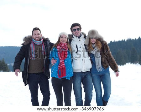 group of friends have fun and relaxing on winter vacation on beautiful sunny day with fresh snow