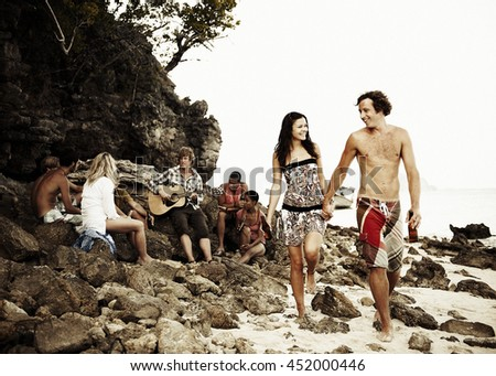 Group of friends having a Beach Party Concept - stock photo