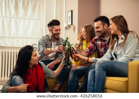Group of friends having a beer toast together. - stock photo