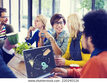 Group of Friends Having a Coffee Break in a Cafe - stock photo