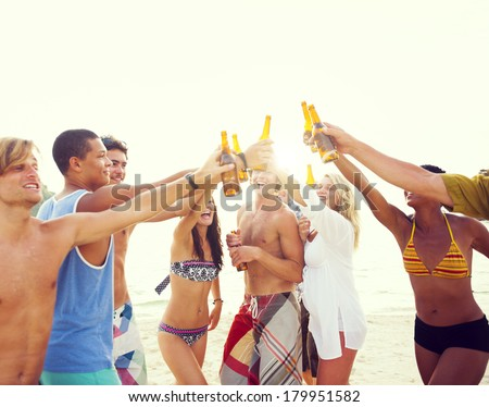 Group of Friends Having a Summer Beach Party - stock photo