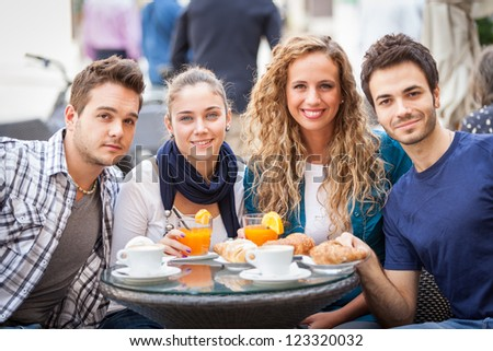 Group of Friends Having a Traditional Italian Breakfast - stock photo