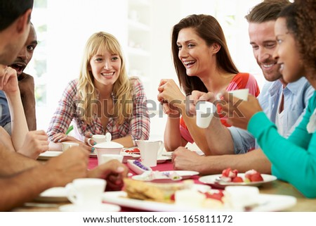Group Of Friends Having Cheese And Coffee Dinner Party - stock photo