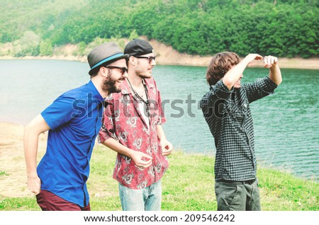 Group of friends having fun and looking in the distance - stock photo