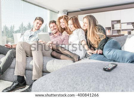 Group of friends having fun and spending time together at home