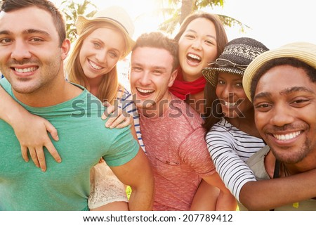 Group Of Friends Having Fun In Park Together - stock photo