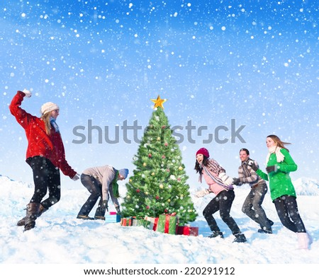 Group of friends having fun in the snow. - stock photo