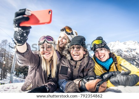 Group of friends having fun on the snow